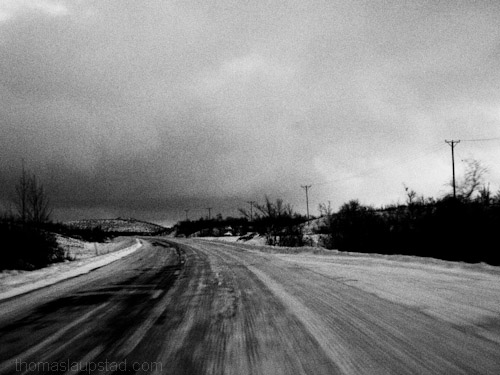 Black and white picture from winter road trip in Northern Sweden